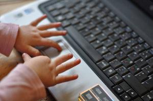 Child touching a keyboard